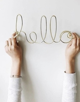 Umbra wall decoration Hello, brass
